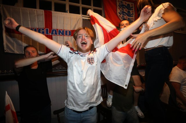 England fans pictured at the Artillery Arms in Portsmouth, UK, watching England play on TV in the Semi-finals at Wembley. Pictured are fans enjoying the night. Picture: Sam Stephenson