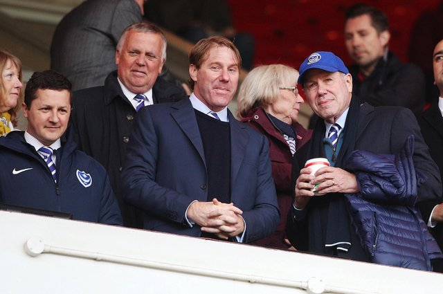Pompey chairman Michael Eisner, right, with son Eric and Andy Redman, left