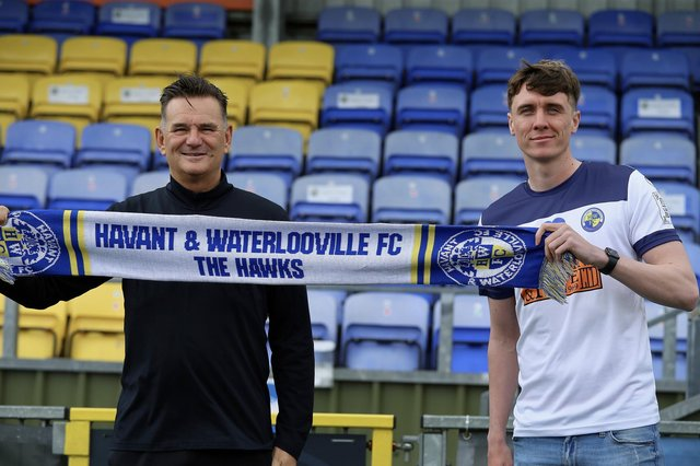 Hawks boss Paul Doswell, left, with new signing Paul Rooney. Picture: Kieron Louloudis
