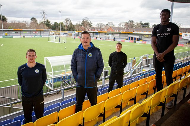 Havant & Waterlooville Pro:Direct Academy head of coaching Joe Oastler, far left, Hawks boss Paul Doswell, second left, and academy players and students Lawson Bright, back centre, and Joel Ngimbi