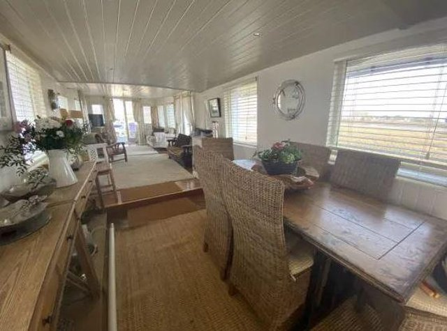 There is an open plan dining area leading to the lounge.