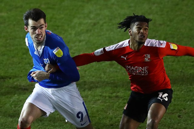 Akin Odimayo, in action for Swindon against Pompey last season, is training with the Blues. Picture: Bryn Lennon/Getty Images