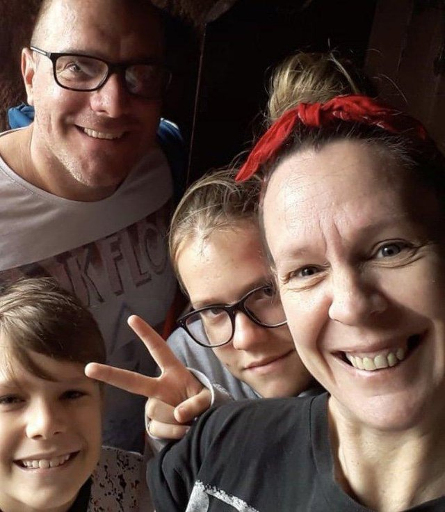 John Arnell, 45, at home with his family.