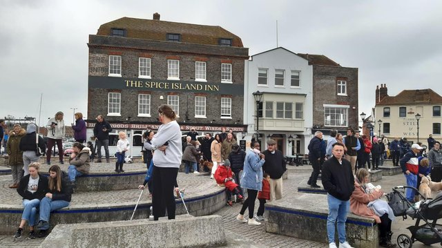 Crowds gather in Bath Square, Old Portsmouth, to watch the salute. Picture: Alan Cooper
