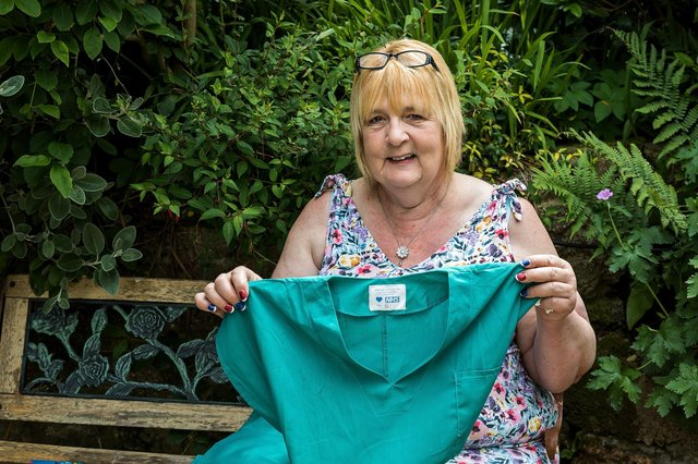 Lin Gell, who has been awarded the British Empire Medal, shows off one of the scrubs produced by Team Scubbers during the pandemic. Picture: Mike Cooter (080621)