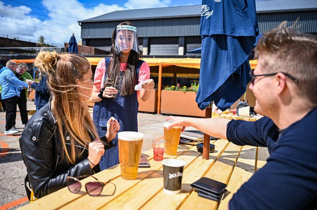 Members of the public enjoy a beer garden. Picture: Jeff J Mitchell/Getty Images