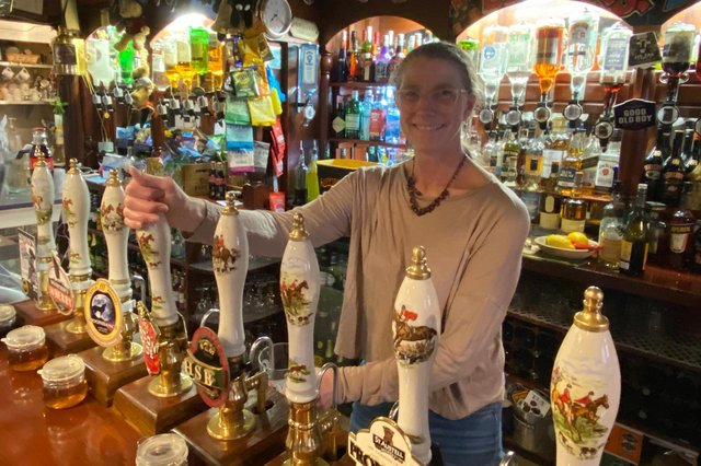 Judith Burr, who has runThe Barley Mows for 15 years, pours a pint as she welcomes customers back into her pub as lockdown eased. Photo: Tom Cotterill