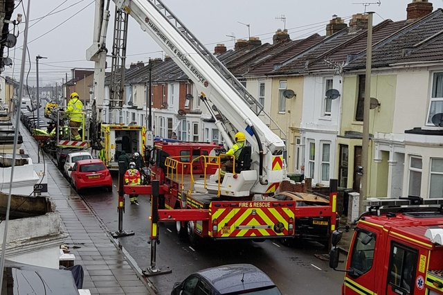 Fire services spotted using an aerial ladder platform to assist in extracting a person from a house in Westfield Road, Eastney