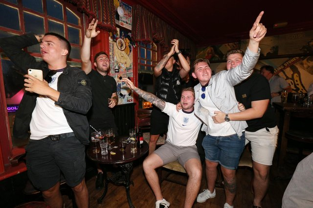 Celebrations at full-time. Fans watch England v Ukraine in the quarter finals of Euro 2020, in The Kings pub, Albert Road, Southsea. Picture: Chris Moorhouse (jpns 030721-22)