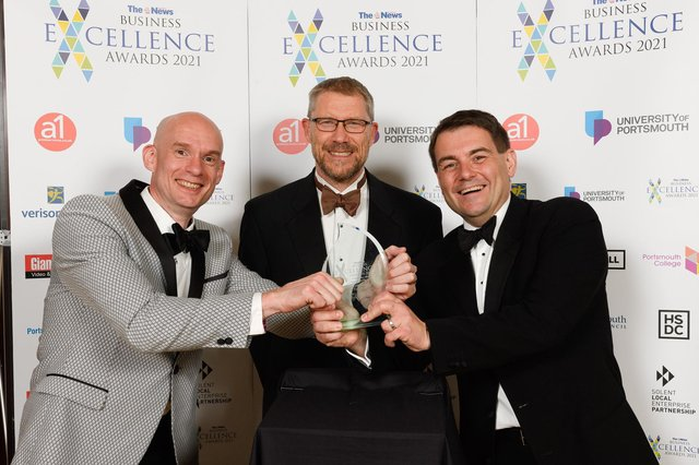 The News Business Excellence Awards 2021. Pictured is: Craig Gordon and Michael Frisbee of Vuzion UK. with Mark Waldron. Picture: Keith Woodland (080721-63)