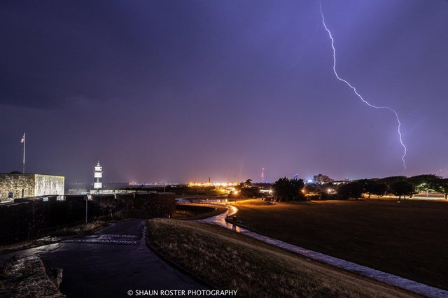 Lightning strike captured in the sky above Portsmouth during a storm.