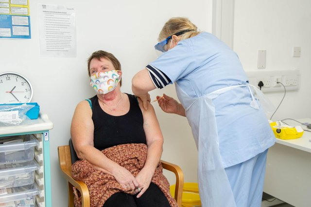 Dr Wendy Peters giving Jackie Blake a vaccination jab at St James Hospital, Portsmouth on 17 February 2021. Picture: Habibur Rahman