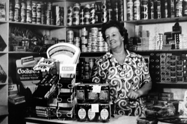 Ethel Morse behind the counter in her shop in Toronto Road, Buckland, Portsmouth. Picture: Tony Davis collection.