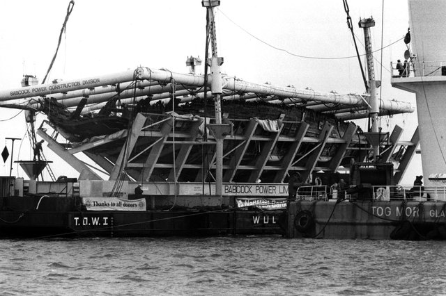 The Mary Rose in its cradle being brought ashore by a barge in October 1982. Picture: The News PP3741