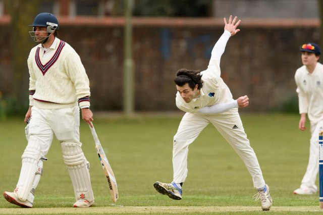 Nick Ward on his way to taking four wickets for the University of Portsmouth at Havant. Picture: Keith Woodland