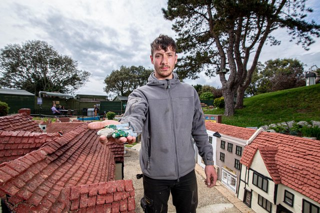 Southsea Model Village assistant manager Harry Wilson pictured last month with some of the damaged miniature figures  Picture: Habibur Rahman