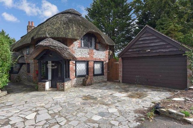 This thatched home in Anmore Lane, Denmead is on sale for £850,000.