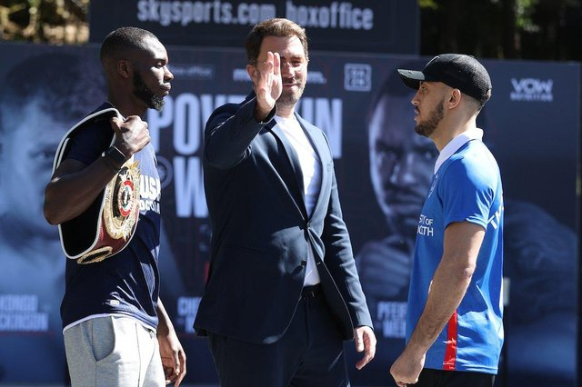 Promoter Eddie Hearn, centre, puts his hand between Mikey McKinson, right, and Chris Kongo. Picture: Mark Robinson/Matchroom Boxing
