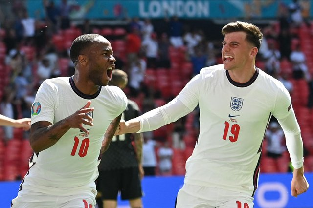 Mason Mount rushes to congratulate Raheem Sterling following his match-winner against Croatia on Sunday.  Picture: GLYN KIRK/POOL/AFP via Getty Images)