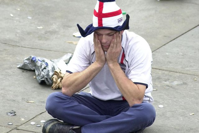 An English football fan looks stunned in Trafalgar Square in central London, Friday June 21, 2002, after seeing his side lose against Brazil in the Quarter-Final tie of the World Cup in Japan's Stadium Ecopa in Shizuoka. PA Photo : Johnny Green.