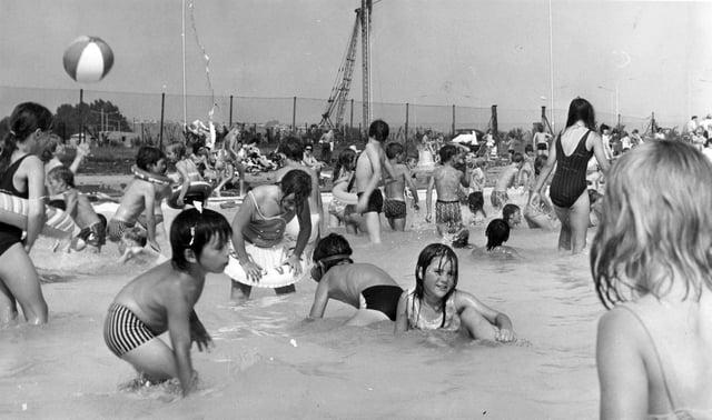 Looks like fun! Children enjoying the splash pool in August 1973