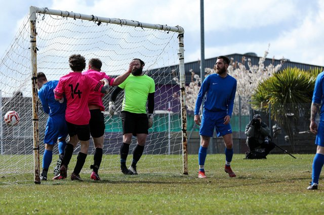 Harry Leigh, third from left, heads home for Freehouse Reserves against Old Boys Athletic at Havant Academy. Picture: Chris Moorhouse