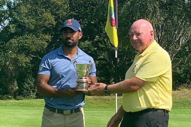 Aman Uddin receives the Lee-on-the-Solent Club Championship from captain Brian Plested after beating Will Green 6&4 in the final. Picture MAHIM UDDIN