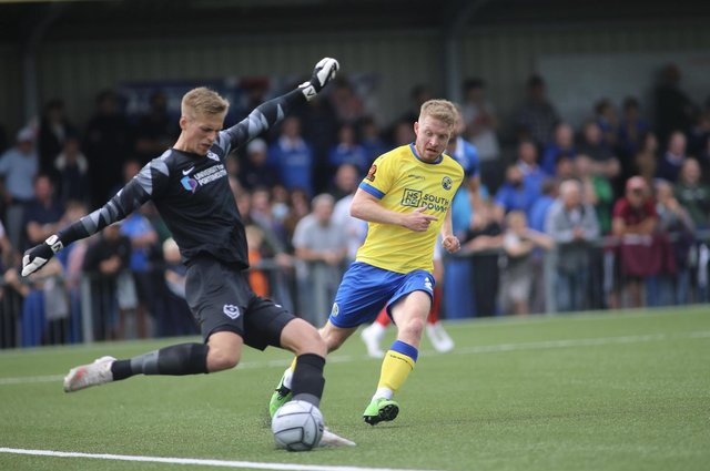 Pompey goalkeeper Alex Bass clears at Hawks. Picture: Kieron Louloudis
