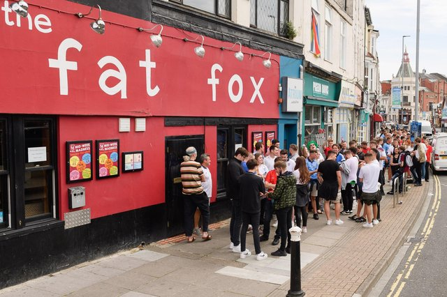 England supporters gather outside The Fat Fox pub ahead of the England v Italy Euro 2020 cup final. Picture: Keith Woodland (110721-15)