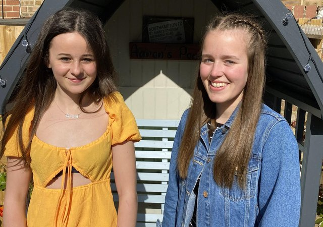 Singers Darcey Jeune (left) and Heidi Bucher have raised £1,450 for the Rowans Hospice.