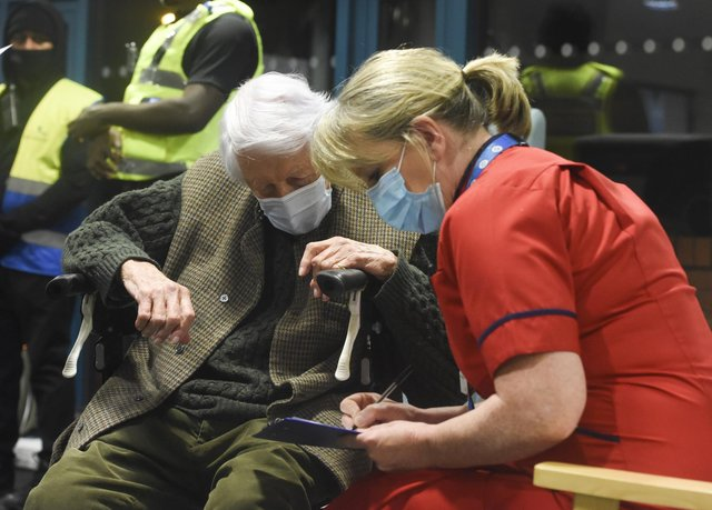 Chief nurse Liz Rix administers a vaccine to Michael Tibbs, 99, the first person in the south west to received a Covid-19 vaccine. Picture: Ewan Galvin/Solent News & Photo Agency