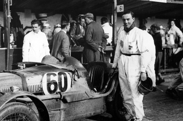 Freddie March standing by his MG Midget No. 60 in which he won the Double Twelve at Brooklands in 1931 and founded the Goodwood Motor Circuit in 1948. Picture: The News PP4799