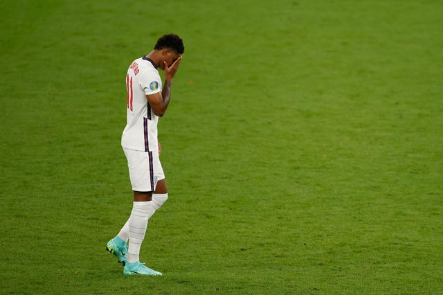 England's forward Marcus Rashford reacts after he fails to score in the penalty shootout during the Euro 2020 final against Italy on Sunday Picture: John Sibley/AFP via Getty Images