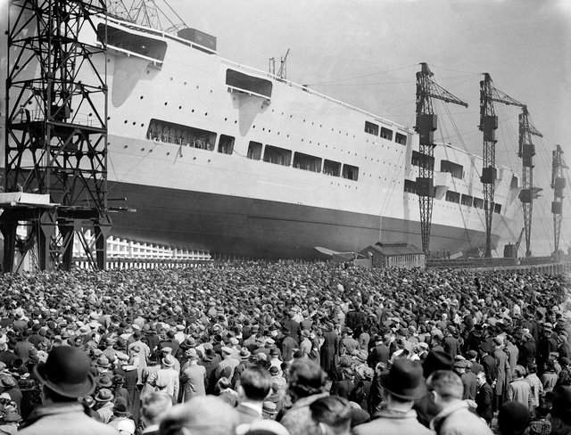 Crowds watch as the 22,000 ton aircraft carrier HMS Ark Royal (91) is launched at the Cammell Laird shipyard in Birkenhead, 13th April 1937. The ship was later sunk off Gibraltar by the German submarine U-81 in November 1941. (Photo by Hudson/Topical Press Agency/Hulton Archive/Getty Images)