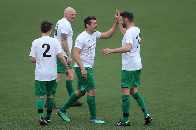 Harry Potter (second right) celebrates his hat-trick goal against FC Strawberry.  Picture: Dave Haines.