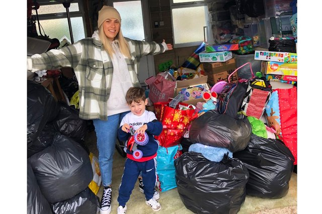 Megan Williams, 29, with her son Marley Wooden, 3, and the donations towards her Christmas hampers for families in need