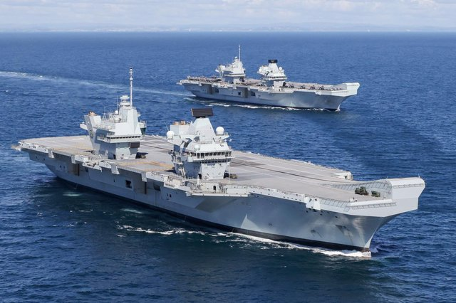 HMS Prince of Wales and HMS Queen Elizabeth pictured at sea for the first time.  Wednesday 19 May 2021 saw a historic moment in Britain's carrier renaissance as HMS Queen Elizabeth and HMS Prince of Wales met at sea for the first time. With two 65,000 tonne carriers in operational service, Britain has a continuous carrier strike capability, with one vessel always ready to respond to global events at short notice.