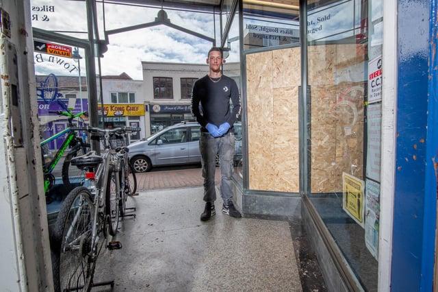 John Partridge next to the damaged front of Town Bikes Picture: Habibur Rahman