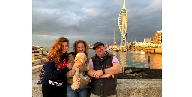Paul Livingston with (left) daughter Eleanor, wife Kate and Poppy the dog