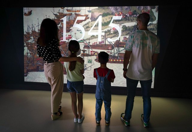 A family watches a preview of the new 1545 experience at The Mary Rose exhibition at Portsmouth Historic Dockyard. Picture: Andrew Matthews/PA Wire