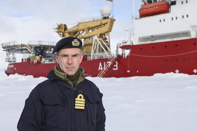Captain Mike Wood, commanding officer of HMS Protector, on the ice while conducting trials in the Arctic. Picture: Royal Navy