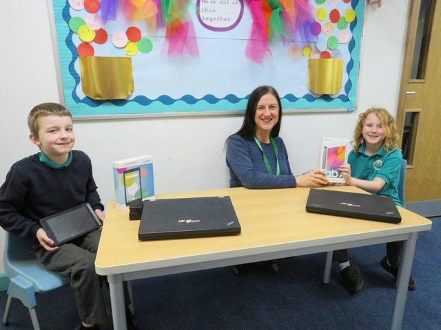 Manor Infant School headteacher Helen Castle welcomes the delivery of the digital devices.