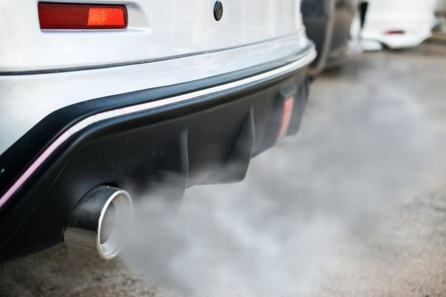 Car belching out fumes from its exhaust