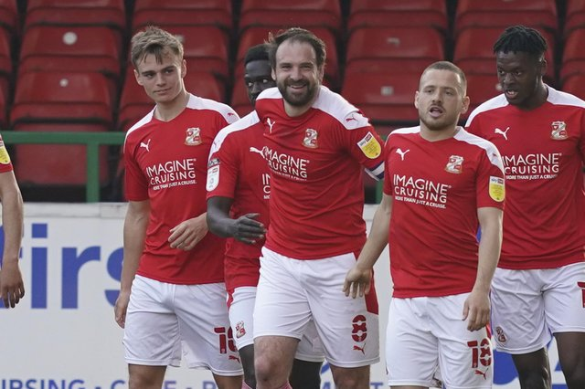 Former captain Brett Pitman scored twice for Swindon in their 3-1 defeat of Pompey. Picture: Jason Brown