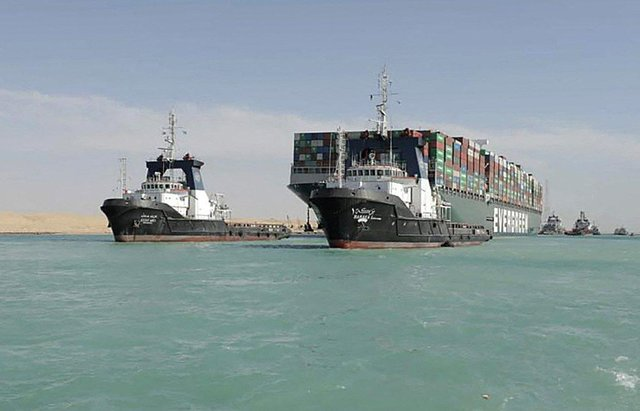 A picture released by Egypt's Suez Canal Authority on March 29, 2021, shows a tugboat pulling the Panama-flagged MV 'Ever Given' container ship after it was fully dislodged from the banks of the Suez. (Photo by - / SUEZ CANAL AUTHORITY / AFP) (Photo by -/SUEZ CANAL AUTHORITY/AFP via Getty Images)