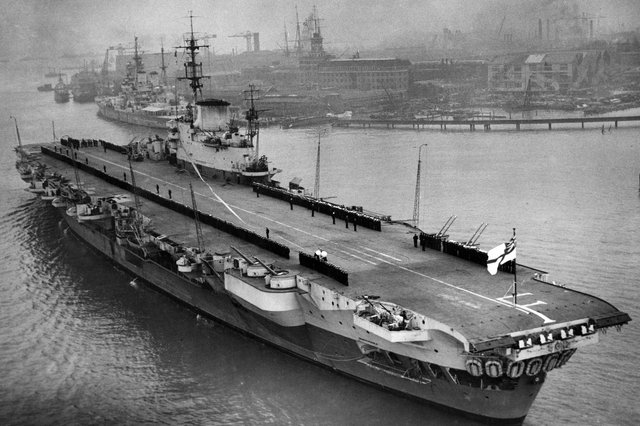 The ship's company lines the deck of the Implacable-class aircraft carrier HMS Indefatigable as she returns to Portsmouth after service in the Far East, March 16, 1946. Picture: Central Press/Getty.