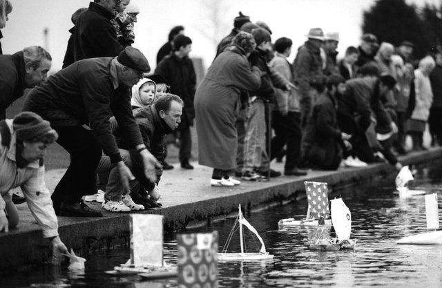 Competitors urge their boats on at the launch of the 1996 Gosport Model Yacht and Boat Club paper boat race.