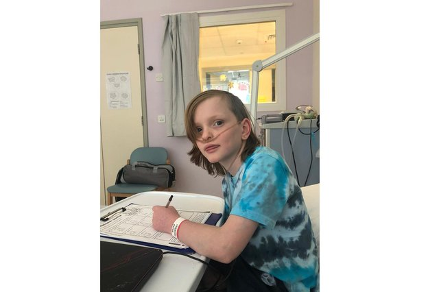 Sam Merrick, 11, was the inspiration for Sam's Haven, a charity set up by his family to help other ill children. Pictured in hospital being treated for a leg abscess in March 2020