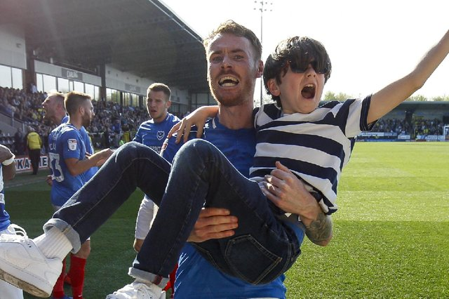 Tom Naylor carries a young fan after Pompey net a late winner at Burton in April 2019. Picture: Daniel Chesterton/phcimages.com/PinPep