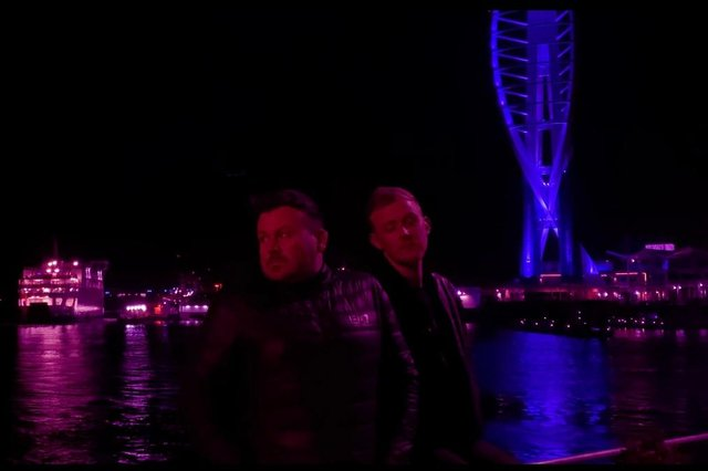 Councillor Rob New, left, is part of a local LGBT band called White Noise Fanatics with his friend and roommate Aled Price, right. The duo are pictured in front of the Spinnaker Tower.